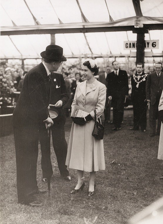 """This year, considering the across the country lockdown, the renowned agricultural occasion will occur as a progression of virtual meetings online without precedent for its 117-year history. As a Patron of the Royal Horticultural Society – a position which she has held since 1952 – the Queen denoted the opening of the show with an endearing message of help.   In an official articulation discharged by Buckingham Palace, she stated: """"My family and I have consistently appreciated visiting the show, and I realize that your individuals and supporters will be baffled that they can't go to face to face this year."""" She included: """"I am certain that my grandma, Queen Mary, who originally went to the Chelsea Flower Show in 1916, would be charmed that numerous individuals today have an excitement for cultivation, and that planting stays a famous distraction in the United Kingdom."""" Though this year she won't smell the sweet blossoms, British Vogue glances back at the Queen's sprightly Chelsea Flower Show design minutes."""
